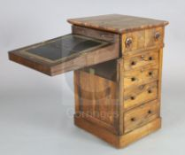 A William IV rosewood davenport, of unusual design with swivelling top enclosing writing slope and