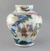 A Chinese wucai baluster vase, Transitional period c.1640, painted with the figure of an immortal