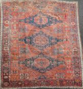 A Soumak red ground carpet, with octagons in a field of geometric motifs and four row border(