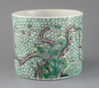 A Chinese famille verte brush pot, Kangxi mark but late 19th century, painted with prunus,
