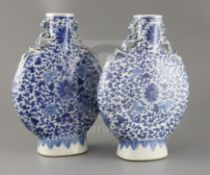 A pair of Chinese blue and white moonflasks, 19th century, each painted with lotus flowers and