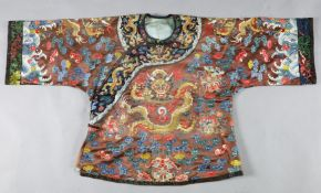 A Chinese embroidered silk and gold thread 'dragon' jacket, late Qing dynasty, the gold thread