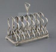 A George III silver seven bar toastrack, by Battie, Howard & Hawksworth?, of rectangular form,