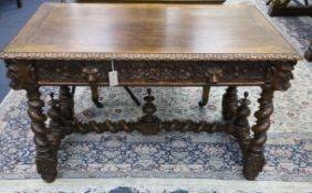 A late 19th century Flemish carved oak side table W.120cm