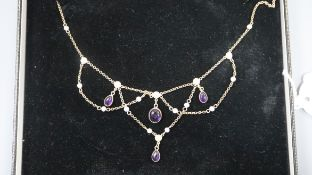 A 375 yellow metal, cabochon amethyst and seed pearl set drop necklace, 62cm.