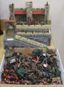 A quantity of Britains and other diecast military figures with fort.