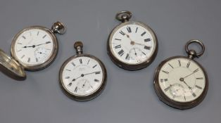 Four assorted silver/white metal pocket watches including a hunter.