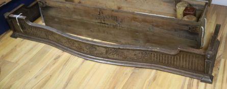 A steel fender of serpentine form