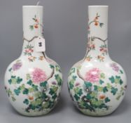 A pair of Chinese famille rose bottle vases H.40cm
