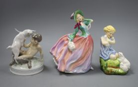 An F.G. Doughty 'My favourite' Doulton figure, 'Autumn breezes' and a Copenhagen figure group.