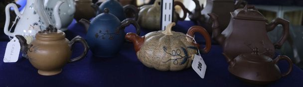 Five Chinese Yixing teapots and a Republic period wine pot