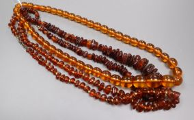 Three assorted clear amber bead necklaces.