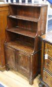 A Regency mahogany graduated open bookcase W.62cm