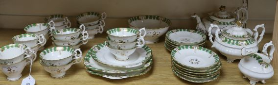 A 19th century Staffordshire gilt and green decorated teaset