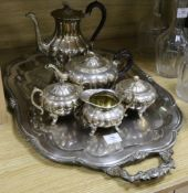 A five piece plated tea and coffee service and a two handled plated tea tray