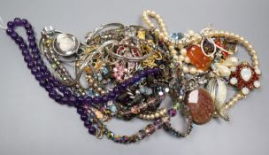 A mixed group of assorted costume jewellery including an amethyst bead necklace.