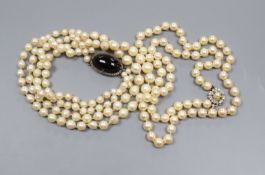 A double strand cultured pearl necklace, with cabochon clasp and a single strand cultured pearl