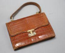 A pre-war crocodile skin handbag