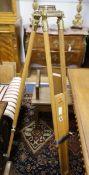 A brass mounted beech instrument tripod