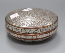 A 19th century Cairo ware silver overlaid copper box and cover Diameter 17cm. approx.