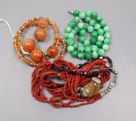 Assorted necklaces including jade and agate.