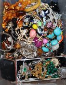 A large quantity of mixed costume jewellery, including silver. amber, malachite etc.