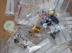A group of assorted unmounted cut gemstones including diamonds, opals, cultured pearls and other