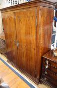 A 19th century German walnut armoire W.148cm