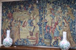 A machine tapestry depicting a medieval wine harvest