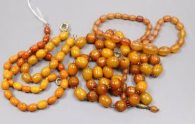 A single strand amber bead necklace, gross 15 grams, one clear amber necklace and two amberoid