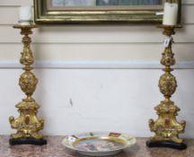 A pair of Renaissance-style candlesticks H.62cm