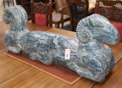 An Eastern painted carved wood double headed ram