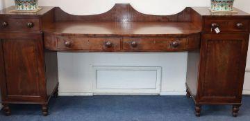 A George IV mahogany pedestal sideboard W.243cm