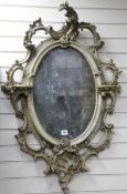 A Victorian gilt gesso wall mirror, with an oval plate H.120cm