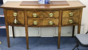 A George III mahogany bow-fronted sideboard with Greek key pattern inlay, fitted four short