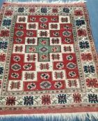 A Turkish ivory ground rug 160 x 130cm