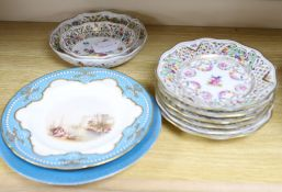 A set of six pierced Dresden plates with two matching graduated bowls and two Continental cabinet