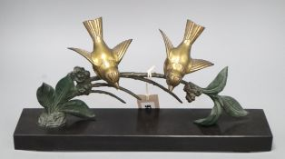 Plagnet, spelter of two birds on a branch, on a black slate base, signed W.40cm Length of base 40cm