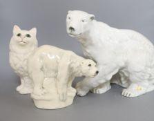 A large Royal Dux model of a polar bear, a Beswick cat and a pottery polar bear Largest polar bear