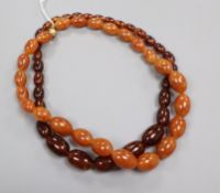 Two simulated amber bead necklaces.