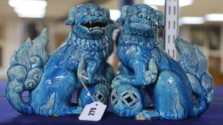 A pair of turquoise ground Buddhistic lions