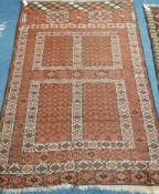 An Afghan terracotta ground rug 180 x 120cm