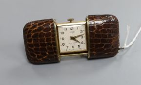 A leather mounted gilt metal cased Lancel, Paris travelling watch, 54mm.