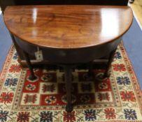 An 18th century mahogany demi lune folding tea table W.76cm