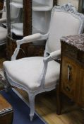 A pair of French painted fauteuils
