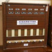 A cigarette vending machine W.67cm
