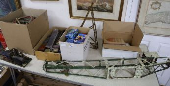 A collection of Meccano including a pre-constructed crane