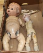 A Max Handwerk bisque-head doll and another doll