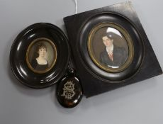 German School, 19th century, two oval portrait miniatures on ivory, the gentleman inscribed