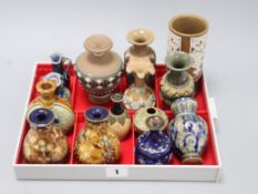 Thirteen Doulton miniature vases and a jug